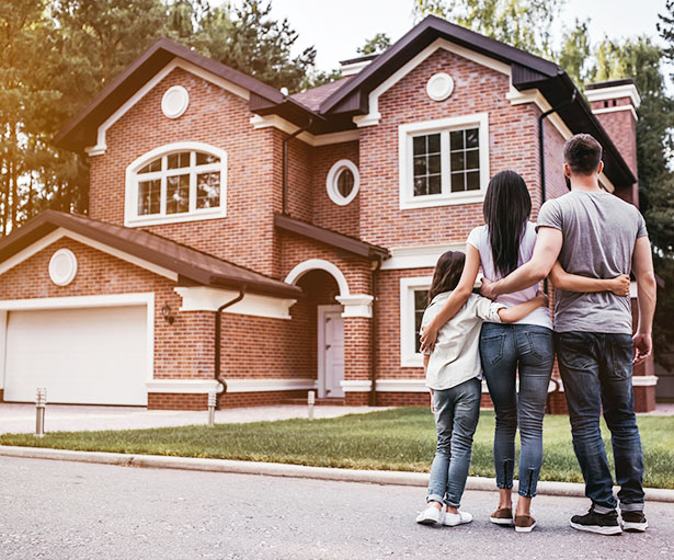 Family looking at their house after being approved for a loan