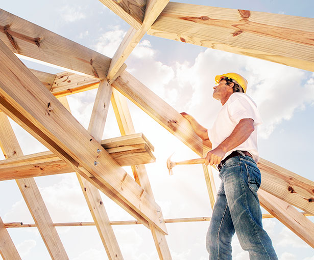Home Renovation Loan of man building a house