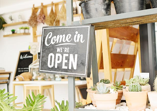 """Store with """"Come in, We are open"""" sign"""