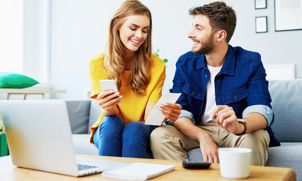 Couple Looking at Receipts on Couch