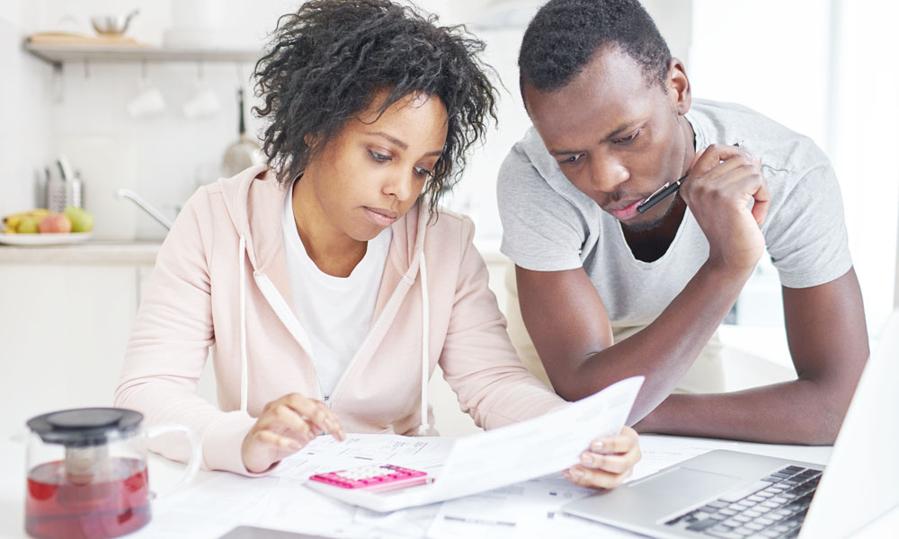 Couple Looking at Papers & Calculations